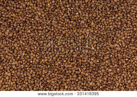 Photo Food Buckwheat Groats. Texture Background Grain Buckwheat Groats. Image Food Product Porridge