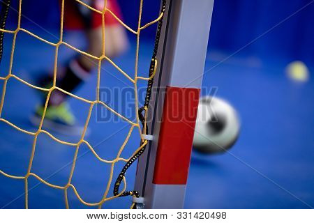 Indoor Soccer Background. Futsal Junior Player On Indoor Training. Soccer Goal With Yellow Net. Socc