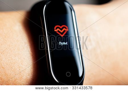 Belarus, Minsk - October 31, 2019: Xiaomi Mi Band 4 On Hand Shows Pulse
