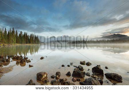 Serene beautiful lake in morning mountains, Oregon, USA.