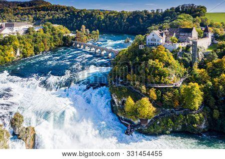 Rhine Falls Or Rheinfall, Switzerland Panoramic Aerial View. Tourist Boat In Waterfall. Bridge And B