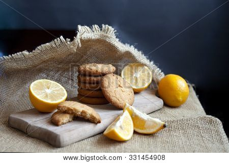 Lemon Gingerbread Cookies Lie On A Wooden Board On A Rustic Table, Still Life Of Fresh Biscuits With