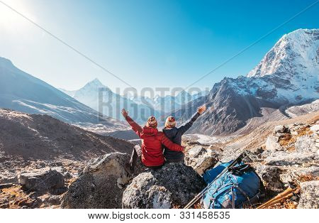 Couple Rising Arms Rejoicing Everest Base Camp Trekking Route Near Dughla 4620m. Backpackers Left Ba