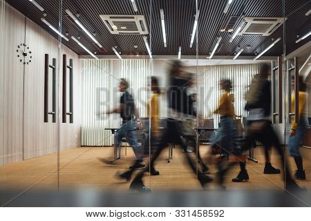 Group Of Office Employees At Coworking Center. Business People Walking At Modern Open Space. Motion