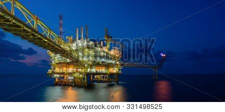 Panorama Of Offshore Oil And Gas Construction Platform In Sun Set Where Produced Raw Gases And Crude