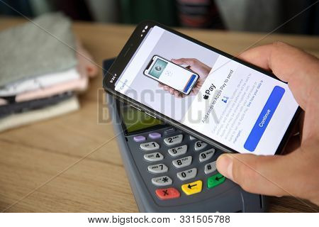 Anapa, Russia - August 12 2019: Man Hand Holding Iphone 11 With Apple Pay On The Screen And Pay Pass