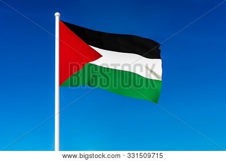 Waving Flag Of Palestine On The Blue Sky Background - 3d Rendered
