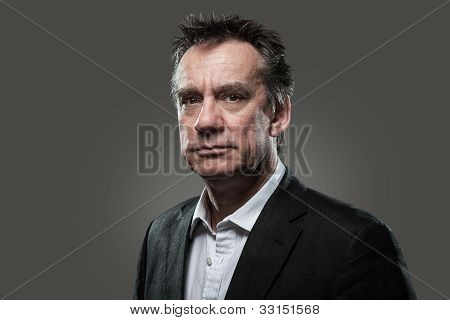 Head Shot of Handsome Business Man in Suit High Contrast