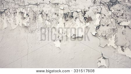 Old Wall With Moldy Peeling White Painting From Humidity. Cracked White Wall As Rusty Concrete Weath