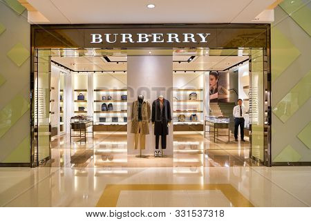 HONG KONG, CHINA - CIRCA JANUARY, 2019: Burberry sign over store entrance in Elements shopping mall. Burberry Group PLC is a British luxury fashion house