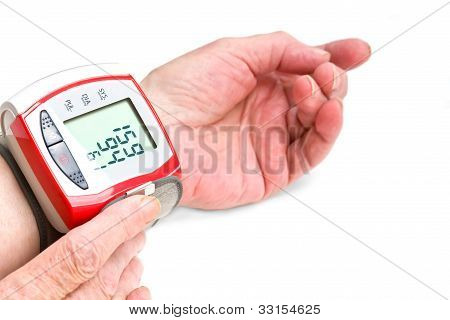 Old Woman's Hands Measuring Blood Pressure