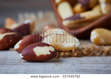 Brazil Nut (bertholletia Excelsa) On Rustic Wooden Background