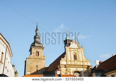 Beautiful Franciscan Monastery In Pilsen, Czech Republic With Light Blue Sky In Background. The Chur