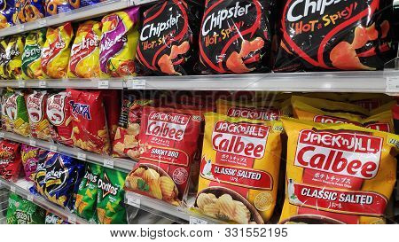 Johor Bahru, Malaysia- 28 Oct, 2019: Wide Selection Of Potato Chip Or Junk Food On Shelf Display In