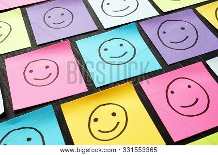 Smiling Happy Faces Drawn On Sheets. Customer Experience And Evaluation Concept.