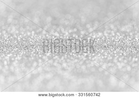 Abstract Silver Texture Glitter Lights Background. De-focused.