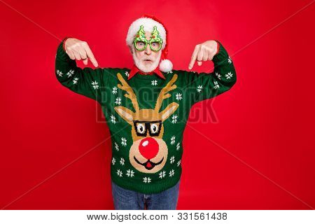 Photo Of Santa Looking On Low X-mas Shopping Prices Indicate Fingers On Cheap Jumper Wear X-mas Tree