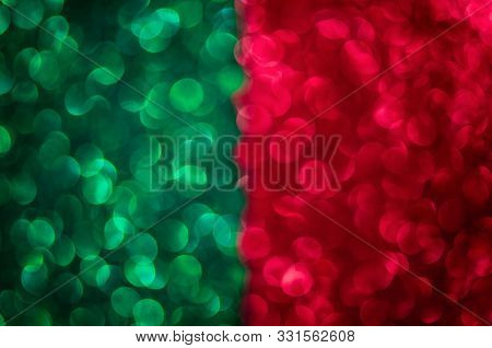 Abstract Two Color Texture Glitter Lights Background. Green, Red. De-focused.