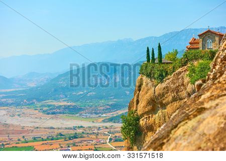 The Monastery of St. Stephen on the rock in Meteora and Thessaly valley, Greece - Greek landscape , copyspace conposition