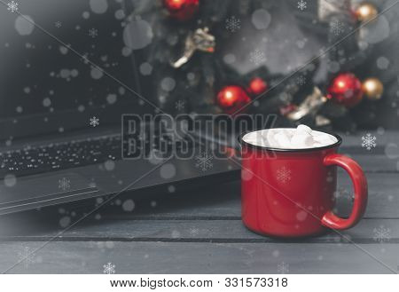 1 Red Mug With Cocoa, Hot Chocolate Or Coffee And Marshmallows Next To A Gray Laptop, Spruce Christm