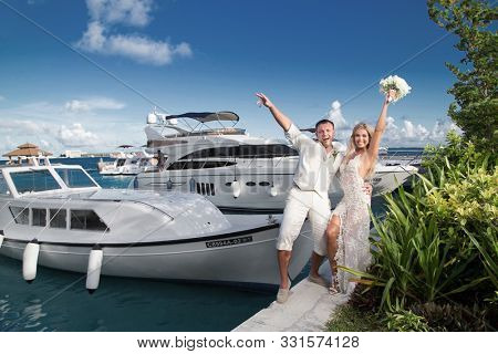Newlyweds have a rest on a yacht