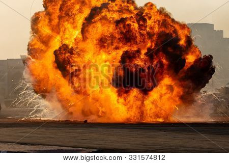Massive Fire Explosion In Military Combat And War. Vehicle Explosure From A Tank In A City In The Mi