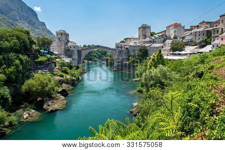 Historic River Bridge And The Famous Sights Of The Balkan. Mostar, Bosnia And Herzegovina.