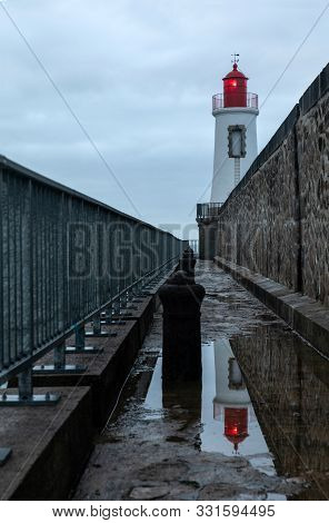 Lighthouse Of The Big Jetty Of Les Sables D Olonne In The Morning (vendee, France)