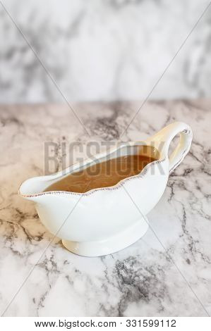 Homemade Turkey Gravy In A Gravy Boat Or Sauceboat Ready For Thanksgiving Day.