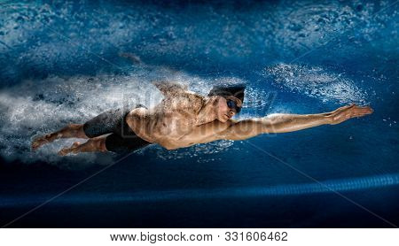 Professional man in swimming pool. View underwater