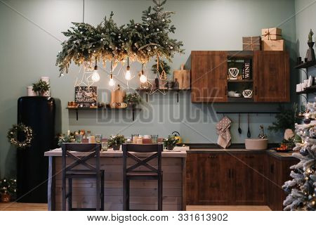 Festive Kitchen In Christmas Decorations. Christmas Living Room Or Dining Room. Beautiful New Year D