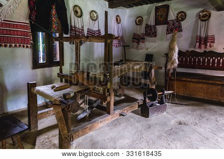 Antique Loom In One Of The Huts Of Oas County Heritage Park In Negresti-oas, Romania