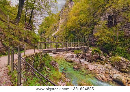 Narrow And Winding Path With The Bridge Over Tolmin Gorge (tolminska Korita). It Located On The Sout