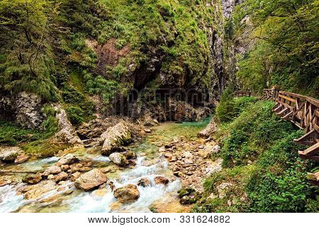 Narrow And Winding Path Along The Gorge. Tolmin Gorge (tolminska Korita). Located On The Southern En