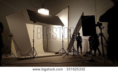 Silhoutte Images Of Video Production And Lighting Set