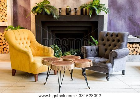 Modern Luxury Home And Living Room, Fireplace And And Armchairs.colorful Wall Decoration, Wooden Cre
