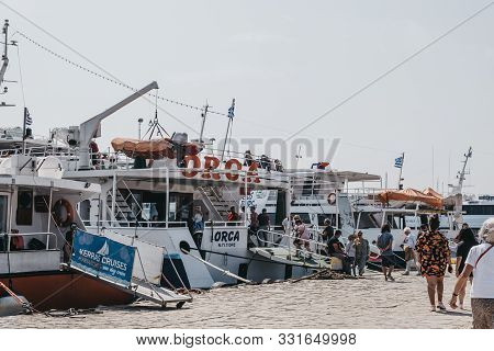 Delos, Greece - September 20, 2019: People Getting On Delos Tours Orca Boat That Is Ready To Leave T