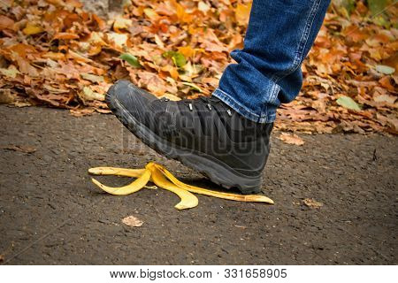 Caution, Risk Of Slipping.the Man Will Slip Over The Banana Peel In A Moment.