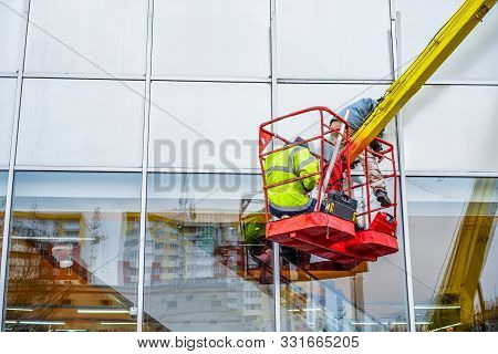 High-altitude Installation Works.  Professional Installation Work On A Telescopic Boom Lift Platform