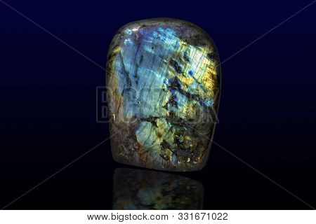 Beautiful Shiny Labradorite Gemstone On Dark Background