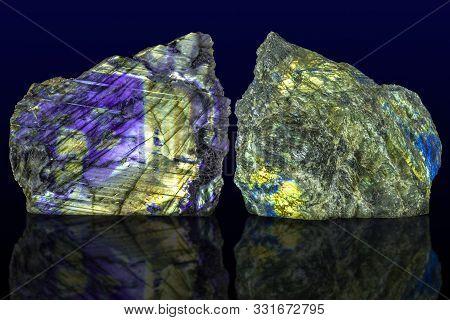 Polished Side And Raw Side Labradorite (labrador) Gemstone On Dark Background