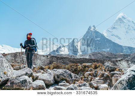 Young Hiker Backpacker Female Taking Brake In Hike Walking Enjoying Valley During High Altitude Ever