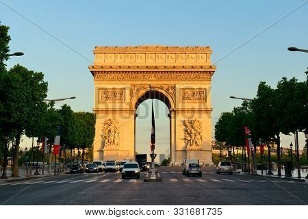 PARIS, FRANCE - MAY 13: Arc de Triomphe and street view on May 13, 2015 in Paris. With the population of 2M, Paris is the capital and most-populous city of France
