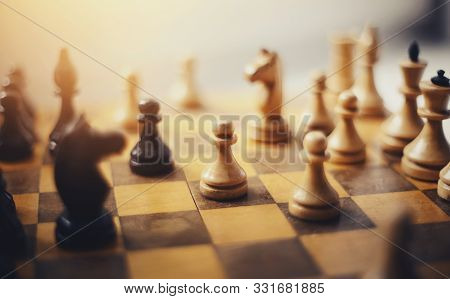 Chess Pieces On The Board. Wooden Chess Pieces On The Chessboard. Intellectual Game -chess.