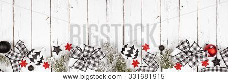 Christmas Banner Of Black And White Checked Buffalo Plaid Ribbon, Gifts And Ornaments. Above View Lo