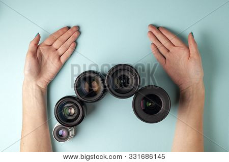 Set Of Photo Lenses On A Colored Background, The Selection And Comparison Of Photographic Equipment,