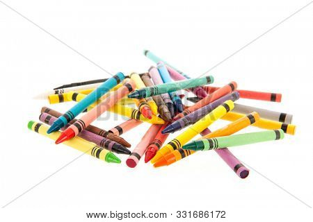 Many colorful crayons isolated over white background