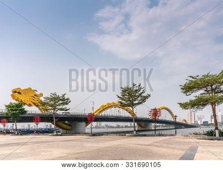 Da Nang, Vietnam - March 10, 2019: Entire Long Cau Rong Or Dragon Bridge Between Green Foliage With