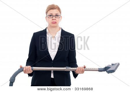 Unhappy desperate businesswoman with vacuum cleaner isolated on white background. poster