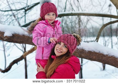 Time Of Mischief And Pranks. Family Winter Fun. Fashionable Stylish Family For A Walk. Mom And Daugh